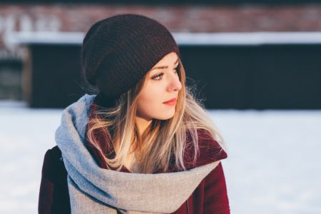 Woman wearing hat in colder weather.